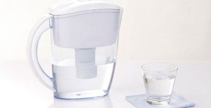 A water filter pitcher and glass of water.